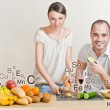Stock Photo: Young lovely couple cooking a balanced diet. Big copyspace. Vita