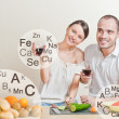 Stock Photo: Young lovely couple cooking balanced diet. Big copyspace. Vita