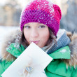 Young lady outdoors holding valentine gift and dreaming — Stock Photo #8659874