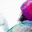 Young lady admiring a present outside in winter — Stock Photo #8659889