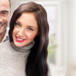 Portrait of young couple standing together at their home. Mortga — Stock Photo #8659911