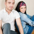 Attractive young couple sitting in their home — Stock Photo #8659918