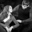 Stock Photo: Fashion style photo of an attractive young couple inside luxury