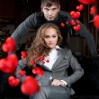 Fashion style photo of an attractive young couple inside luxury - Stock Photo