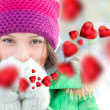 Happy girl thinking of love and having fun outdoors in winter — Stock Photo