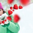 Happy girl thinking of love and having fun outdoors in winter — Stock Photo #8659986