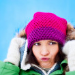 Beautiful Winter Woman outdoors against blue sky having fun and — Stock Photo