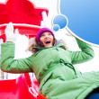 Portrait of young pretty playful woman riding down at playground — Stock Photo