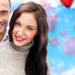 Beautiful young couple embracing and looking at camera. Standing — Stock Photo #8660120