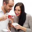 Portrait of young beautiful couple having tea or coffee beverage — Stock Photo #8660144