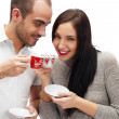 Royalty-Free Stock Photo: Portrait of young beautiful couple having tea or coffee beverage