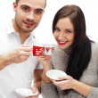 Portrait of young beautiful couple having tea or coffee beverage — Stock Photo