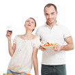 Young lovely couple cooking a balanced diet on a white backgroun — Stock Photo