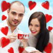 Portrait of young beautiful couple having tea or coffee beverage — Stock Photo #8660177