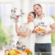 Playful young couple in their kitchen preparing healthy food and — Stock Photo #8660191