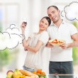 Lovely romantic couple in casuals enjoying a goodtime in kitchen — Stock Photo #8660243