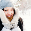 Portrait of young beautiful girl outdoors in winter having fun a — Stock Photo #8660261