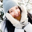 Portrait of young beautiful girl outdoors in winter having fun a — Stock Photo #8660275