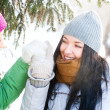 Two happy young girls having fun in winter park — Stock Photo #8660277