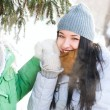 Two happy young girls having fun in winter park — Stock Photo #8660286