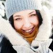 Portrait of young beautiful girl outdoors in winter having fun a — Stock Photo #8660287