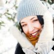 Portrait of young beautiful girl outdoors in winter having fun a — Stock Photo