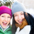 Two happy young girls having fun in winter park — Stock Photo #8660299