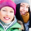 Two happy friends having fun in winter — Stock Photo