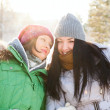 Two winter women walking and chatting together in winter park. — Stock Photo