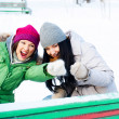 Two happy young girls having fun in winter park — Stock Photo