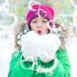 Young lady happily playing in snow in winter - Stock Photo