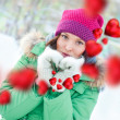 Happy girl thinking of love and having fun outdoors in winter — Stock Photo #8660419