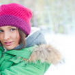 Winter woman in snow looking at camera outside on snowing cold w — Stock Photo #8660695