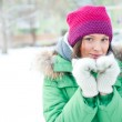 Winter woman in snow looking at camera outside on snowing cold — Stock Photo #8660736