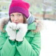 Winter woman in snow looking at camera outside on snowing cold — Stock Photo #8660739