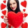 Young pretty attractive smiling woman with with soft heart toy i — Stock Photo