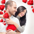 Beautiful young love couple embracing against a white background — Stock Photo #8660863