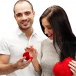 Portrait of handsome young man proposing marriage to a beautiful — Stock Photo