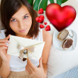 Young pretty attractive smiling woman with heart lying relaxed a — Stock Photo