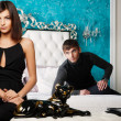 Fashion style photo of an attractive young couple inside luxury — Stock Photo #8661160