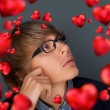 Image of young man thinking of his plans about Valentine day and — Stock Photo