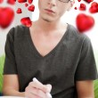 Young adult man writing a valentine letter to his girlfriend whi — Stock Photo