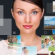 Portrait of young happy woman sharing his photo and video files - Stock Photo
