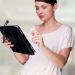 Portrait of young pretty woman holding tablet computer — Stock Photo #8661541