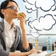 Portrait of a beautiful young businesswoman thinking. Office bac — Stock Photo #8661663