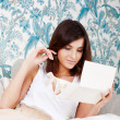 Portrait of young attractive happy woman, reading valentine card — Stock Photo #8661851