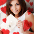 Portrait of young attractive happy woman, reading valentine card — Stock Photo
