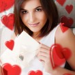 Portrait of young attractive happy woman, reading valentine card — Stok fotoğraf