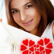 Portrait of young attractive happy woman, reading valentine card - Stockfoto