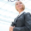 Portrait of a cute business woman with her laptop inside office — Stock Photo #8661934